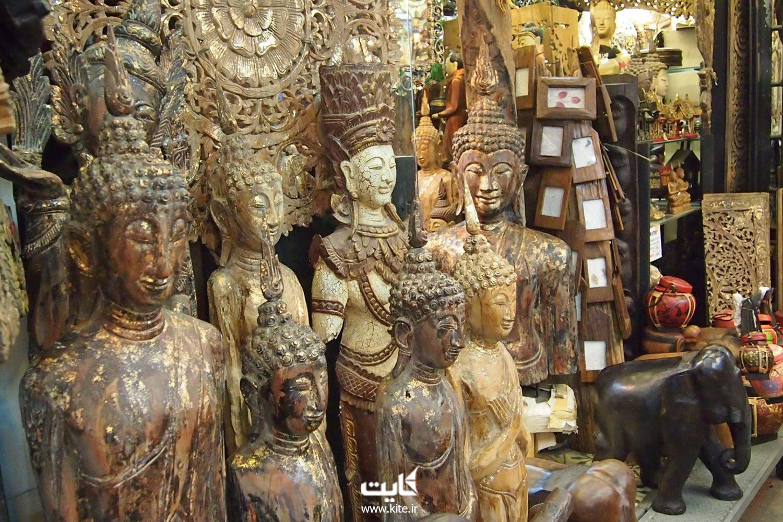 مجسمههای بودا و فیلهای چوبی